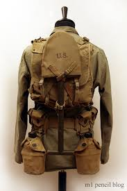 "Field Marching Pack: M1941 Haversack, M1941 Suspenders, shelter half, e-tool. An ""upgraded"" Marching Pack designed for field marches that included bivouac."
